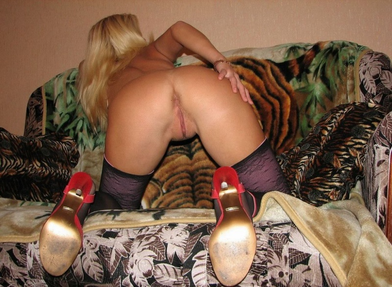 Playful bitch with narrow pussy spreads long legs on a sofa 6 photo
