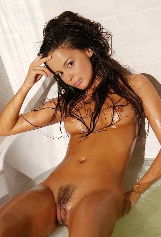 Tanned brown-eyed beauty is bathed in the tub 6 photo