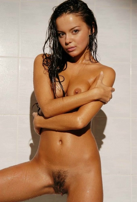Tanned brown-eyed beauty is bathed in the tub 13 photo