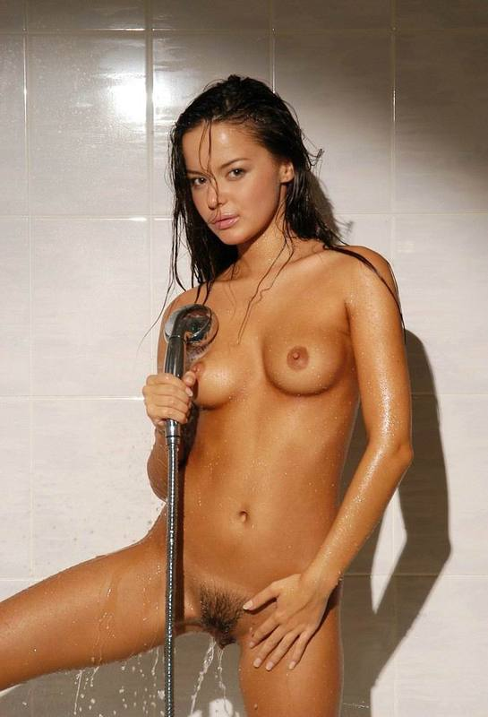 Tanned brown-eyed beauty is bathed in the tub 8 photo