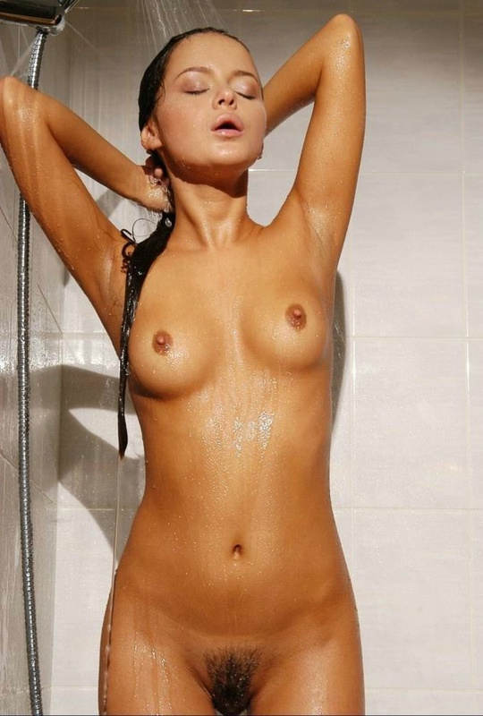 Tanned brown-eyed beauty is bathed in the tub 16 photo