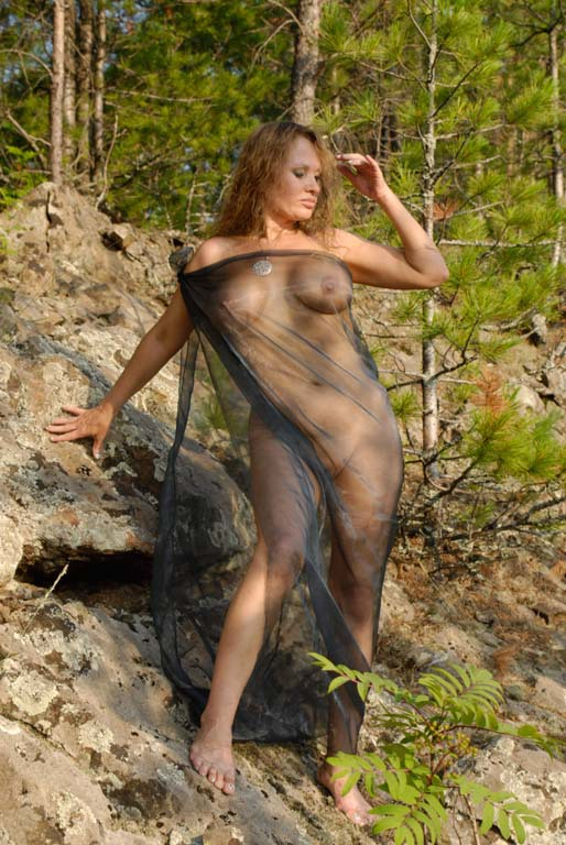 Mature babe with tender pink pussy posing on a rocky cliff 6 photo