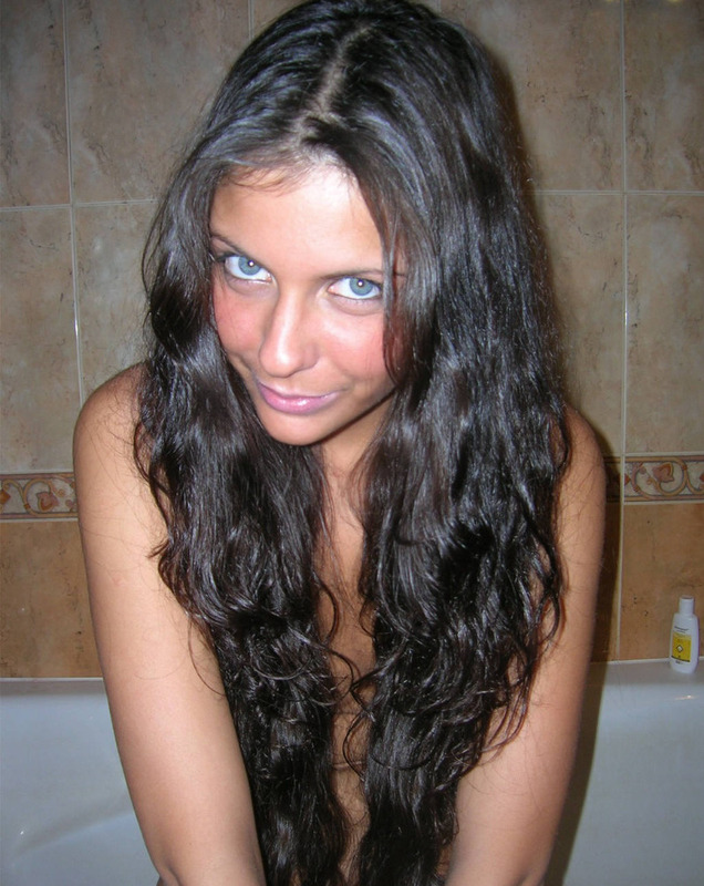 Blue-eyed attractive brunette completely naked 3 photo