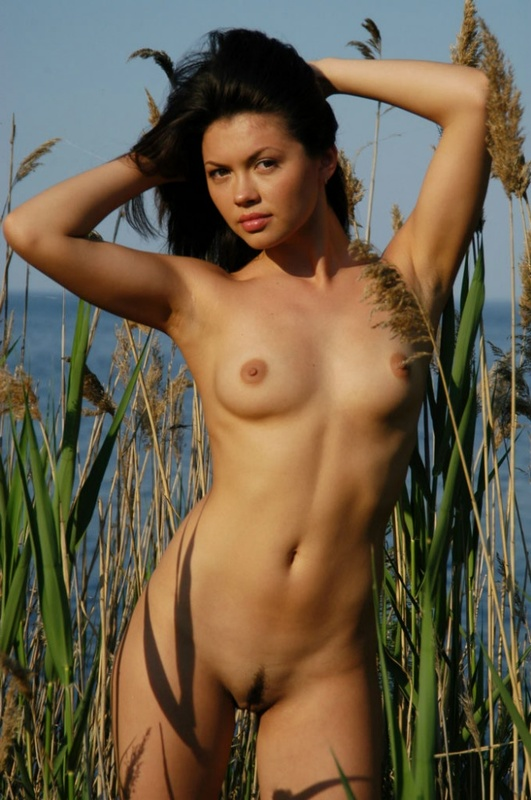 Sexy girl with a black stripe on pussy posing near lake 2 photo