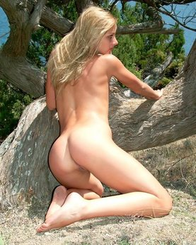 Wild blonde with beautiful elastic ass outdoors