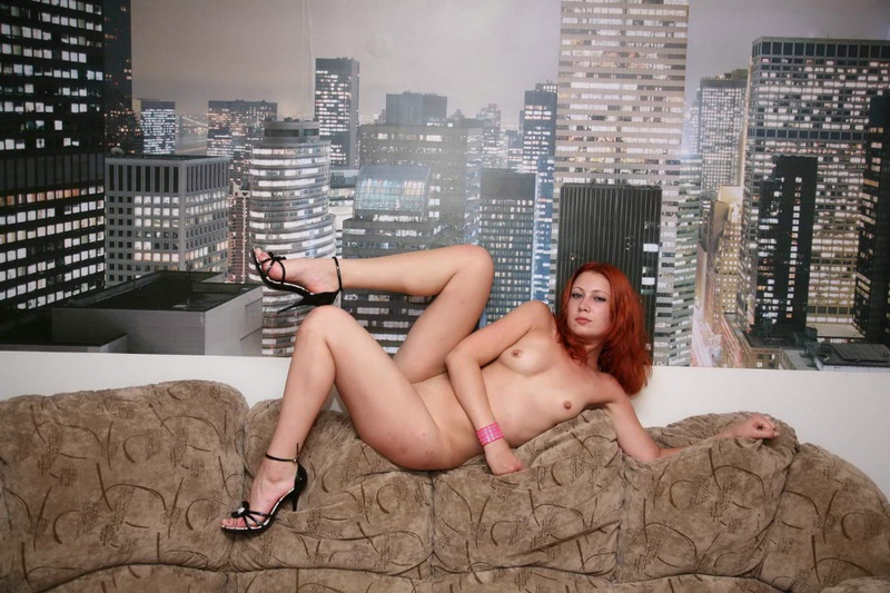 Redhead bitch took off string panties and shows pussy on a sofa 2 photo