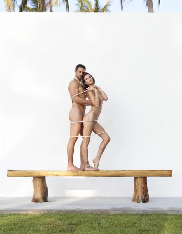 Beautiful couple posing nude on the big wooden bench 11 photo