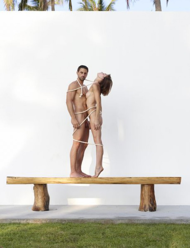 Beautiful couple posing nude on the big wooden bench 6 photo