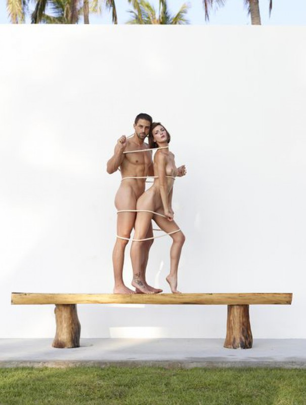 Beautiful couple posing nude on the big wooden bench 8 photo