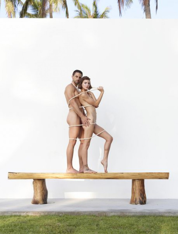 Beautiful couple posing nude on the big wooden bench 2 photo