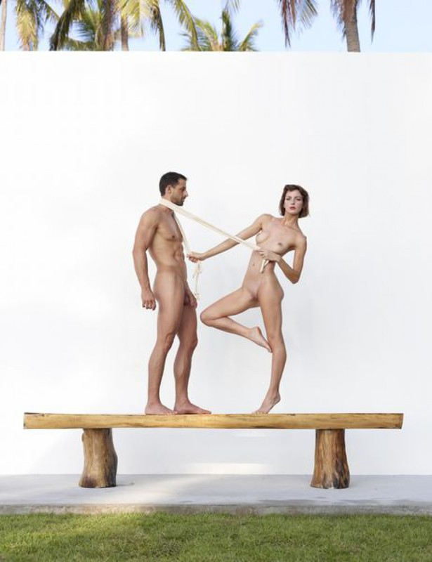 Beautiful couple posing nude on the big wooden bench 4 photo