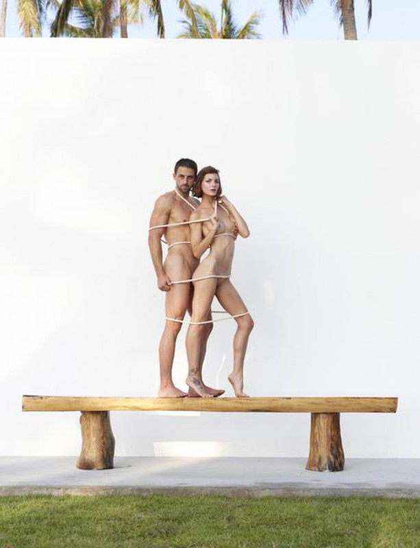 Beautiful couple posing nude on the big wooden bench 5 photo