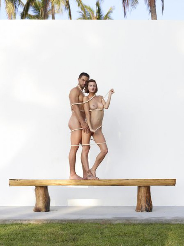 Beautiful couple posing nude on the big wooden bench 23 photo