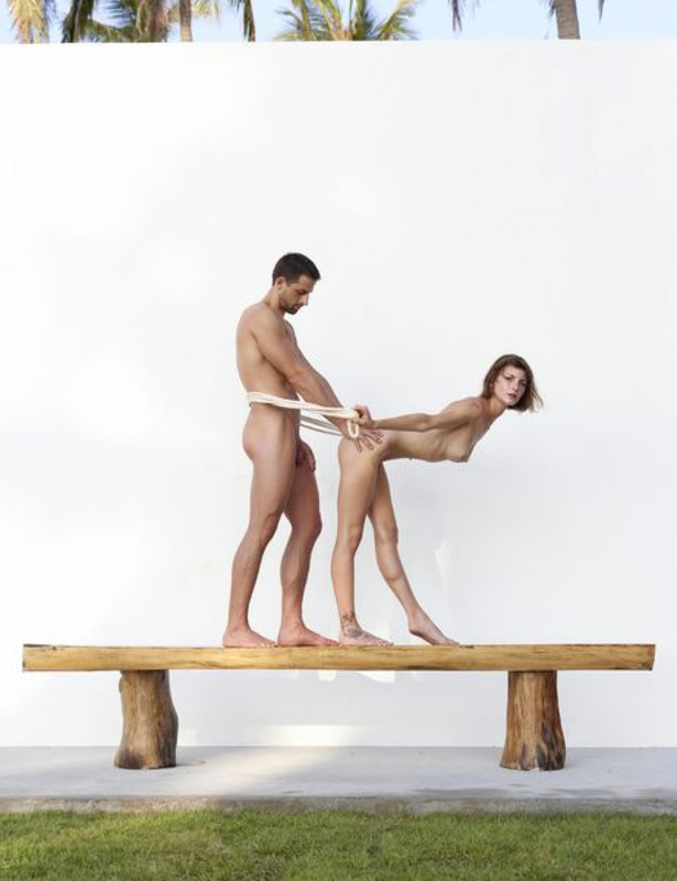 Beautiful couple posing nude on the big wooden bench 25 photo