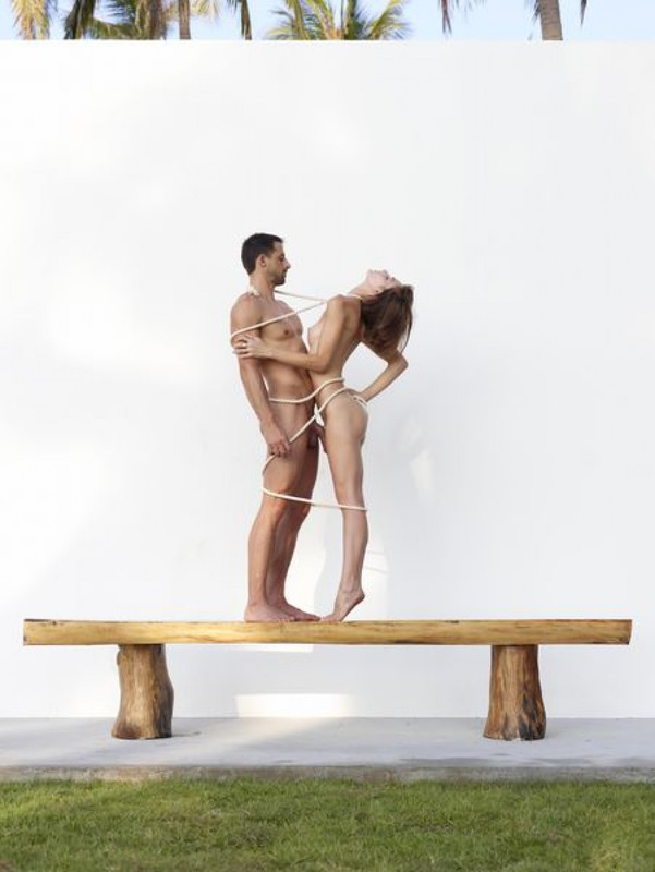 Beautiful couple posing nude on the big wooden bench 26 photo
