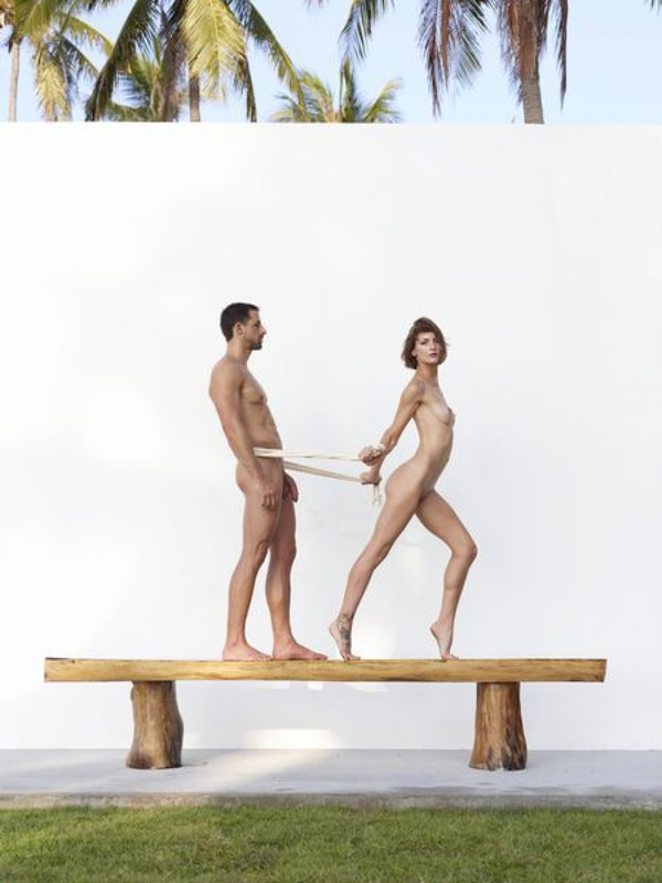 Beautiful couple posing nude on the big wooden bench 15 photo