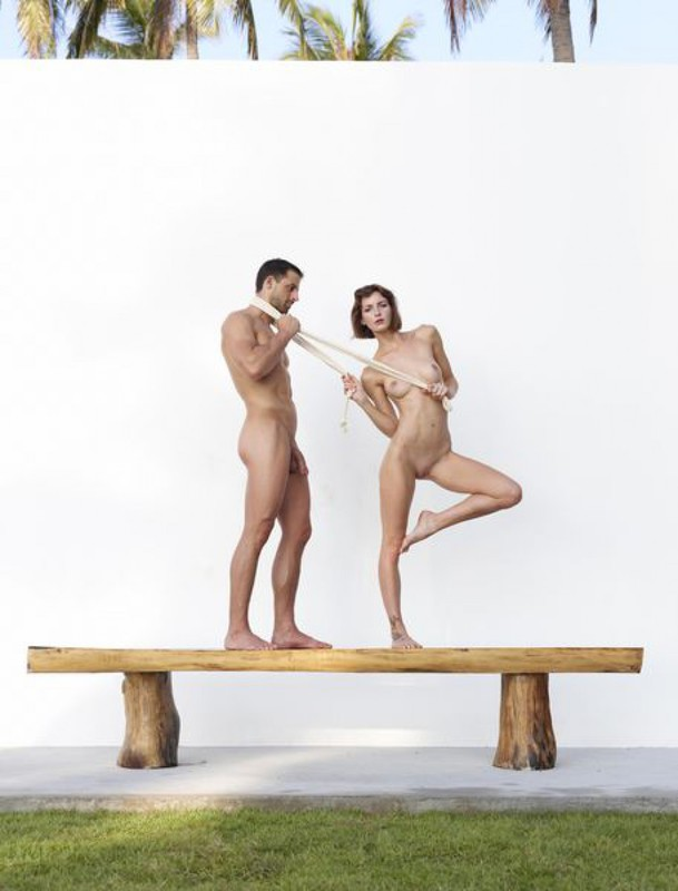 Beautiful couple posing nude on the big wooden bench 29 photo