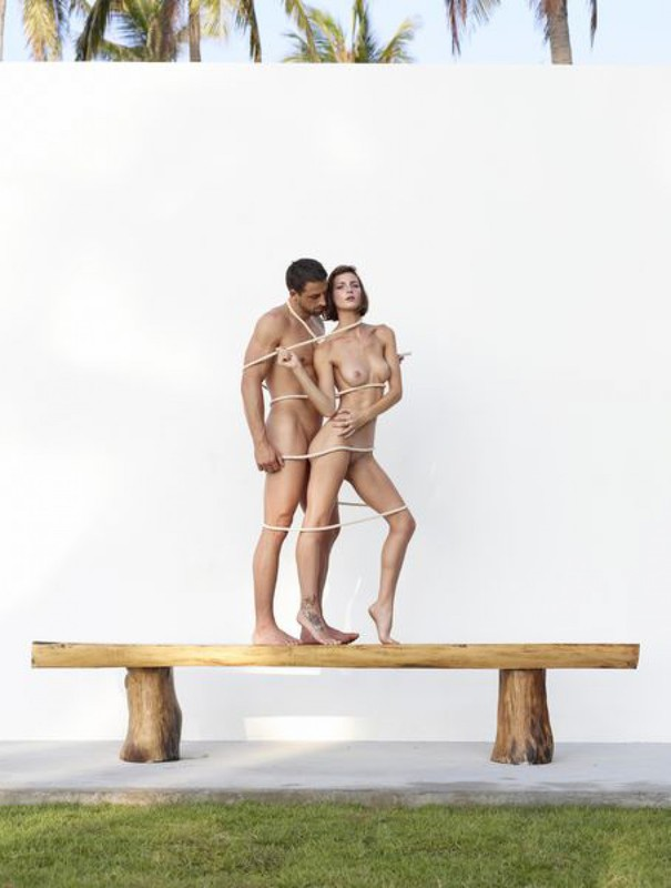 Beautiful couple posing nude on the big wooden bench 19 photo