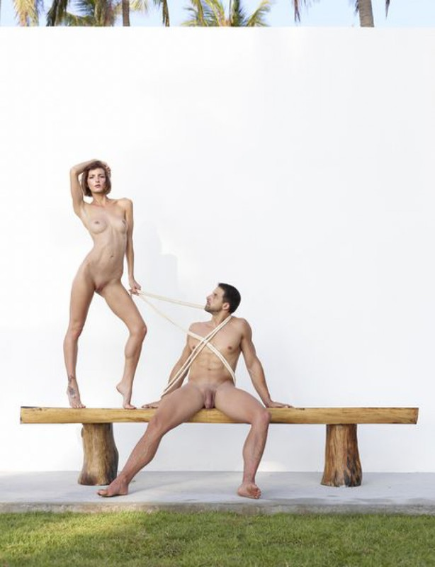 Beautiful couple posing nude on the big wooden bench 24 photo