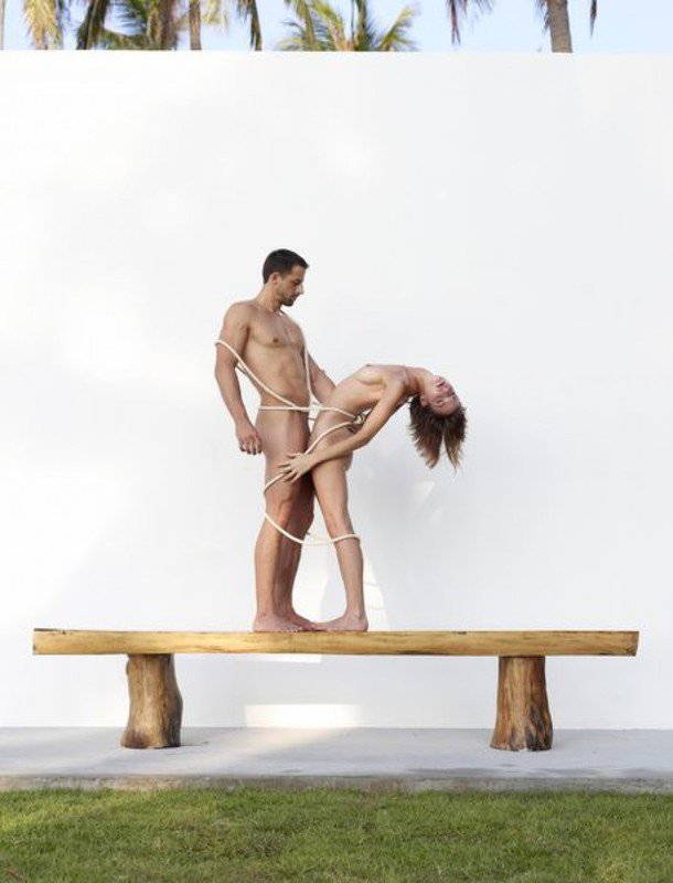 Beautiful couple posing nude on the big wooden bench 32 photo