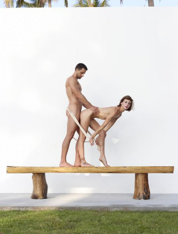 Beautiful couple posing nude on the big wooden bench 30 photo