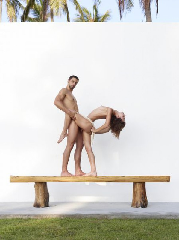 Beautiful couple posing nude on the big wooden bench 13 photo