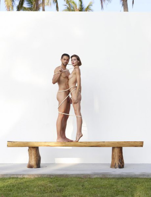 Beautiful couple posing nude on the big wooden bench 28 photo