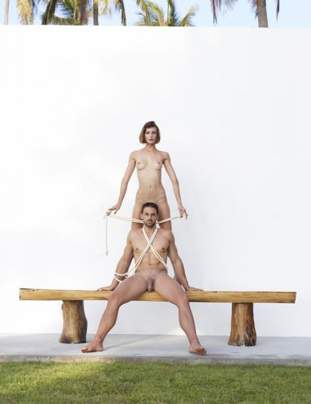 Beautiful couple posing nude on the big wooden bench 14 photo