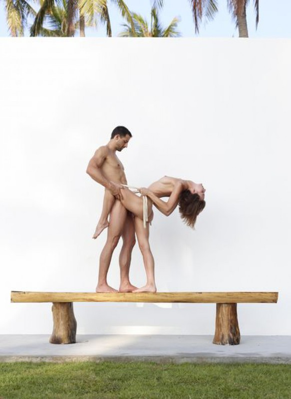 Beautiful couple posing nude on the big wooden bench 18 photo