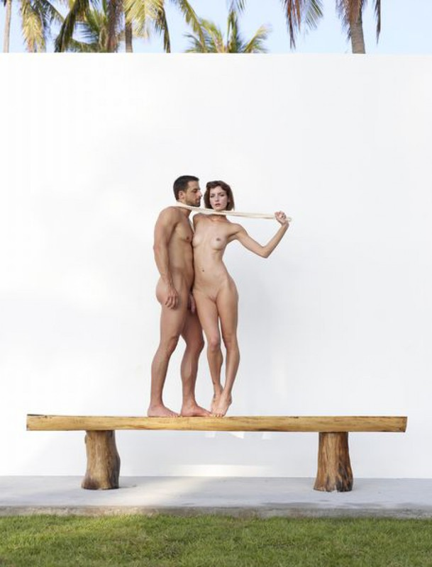 Beautiful couple posing nude on the big wooden bench 27 photo
