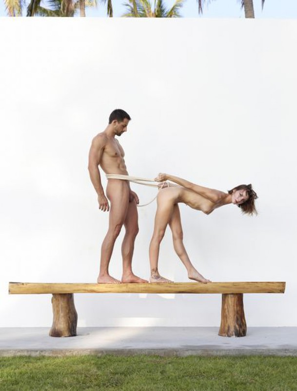 Beautiful couple posing nude on the big wooden bench 21 photo