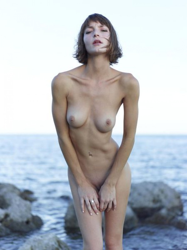 Slender Ninel posing naked on the seashore 2 photo