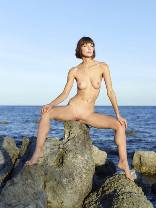 Slender Ninel posing naked on the seashore 3 photo