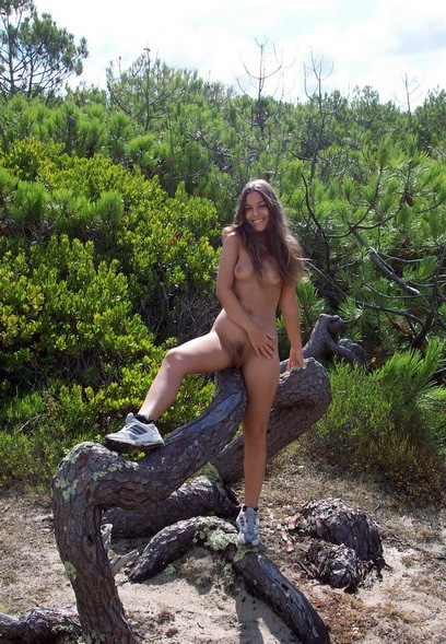 Attractive curly in the nude fun on nature 3 photo