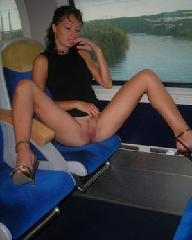 Playful Brunette without panties likes to show pussy in transport and outdo ...