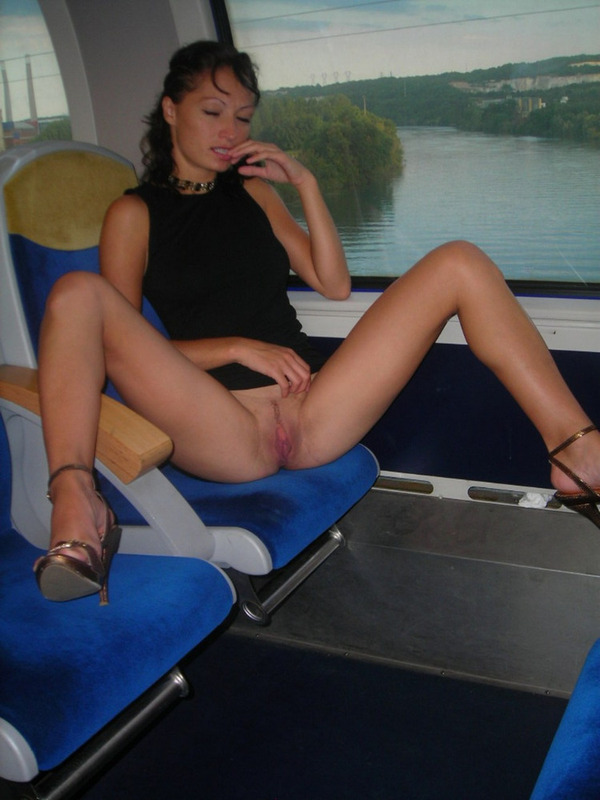 Playful Brunette without panties likes to show pussy in transport and outdoors 4 photo