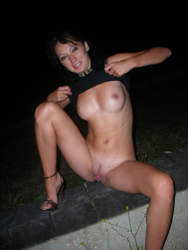 Playful Brunette without panties likes to show pussy in transport and outdoors 12 photo