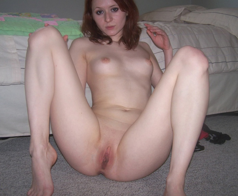 Red-haired bitch caresses her pussy using playful fingers 13 photo