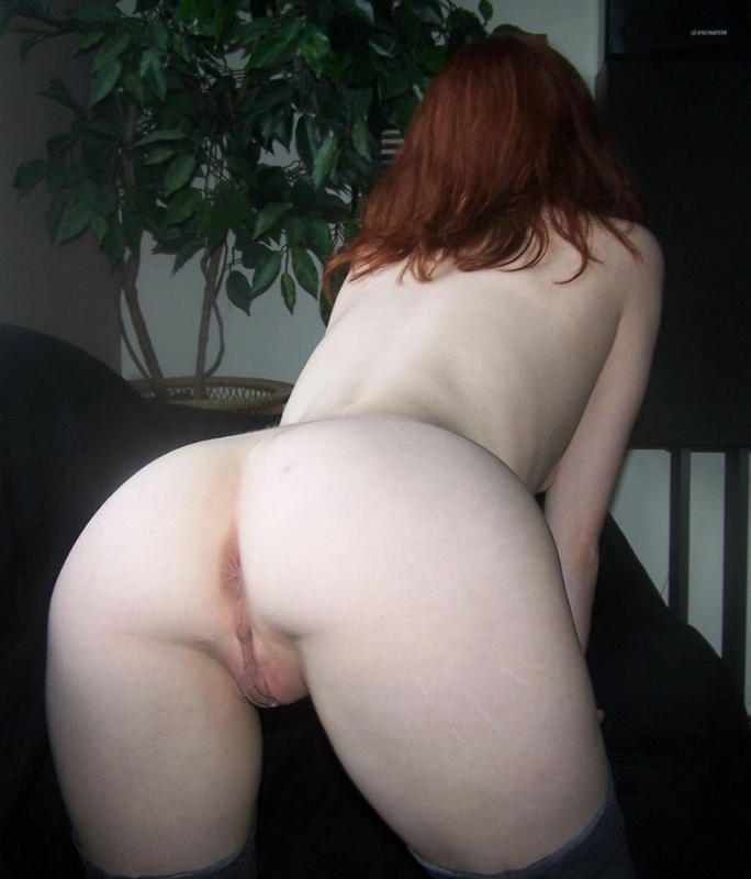 Red-haired bitch caresses her pussy using playful fingers 8 photo
