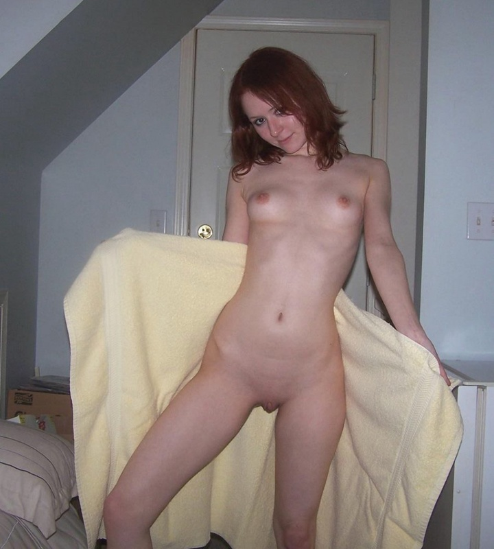 Red-haired bitch caresses her pussy using playful fingers 3 photo