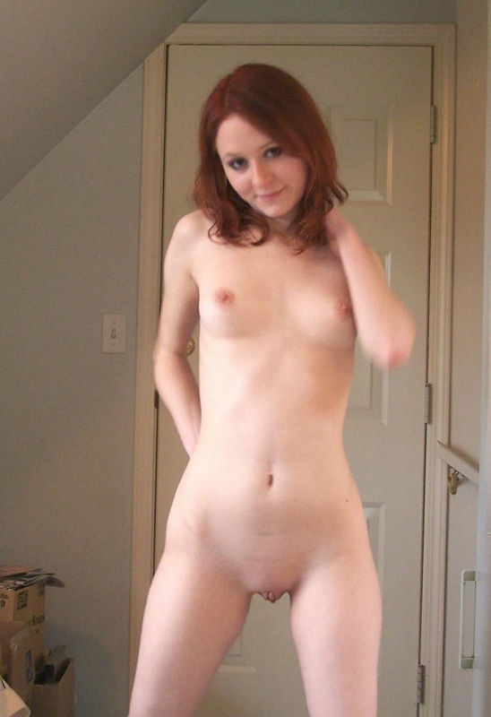 Red-haired bitch caresses her pussy using playful fingers 5 photo