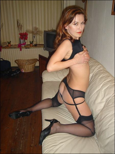 Shiny mom in sexy black lingerie and stockings 8 photo