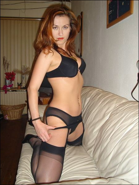 Shiny mom in sexy black lingerie and stockings 6 photo
