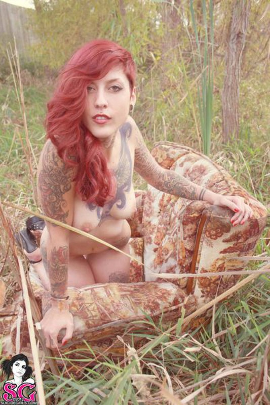 Redhead lusty babe in a tattoo posing on country meadow 25 photo