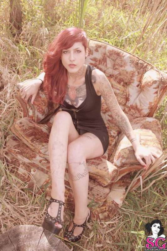 Redhead lusty babe in a tattoo posing on country meadow 33 photo