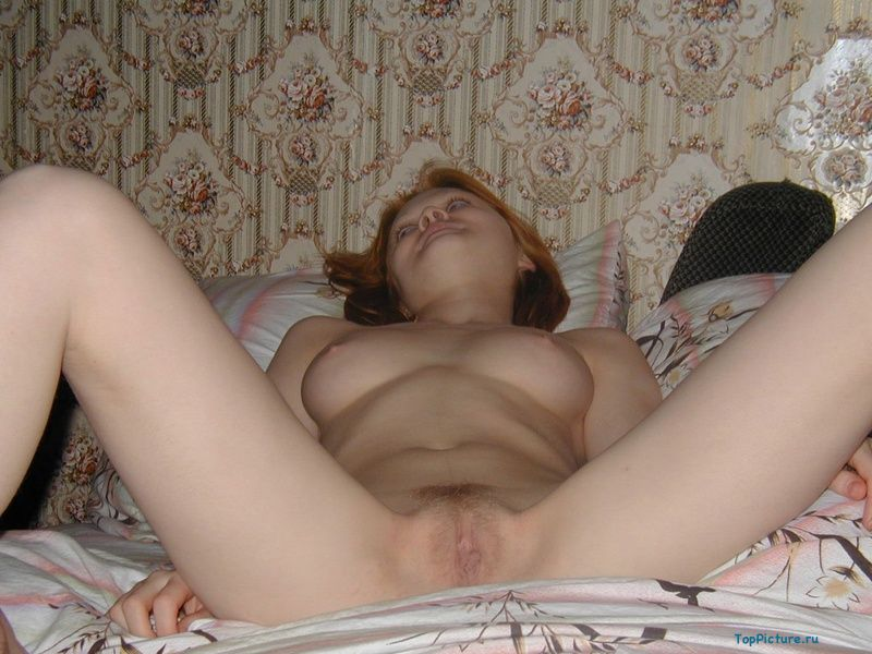 Redhead sucks her boyfriend and gives her pussy licking 10 photo