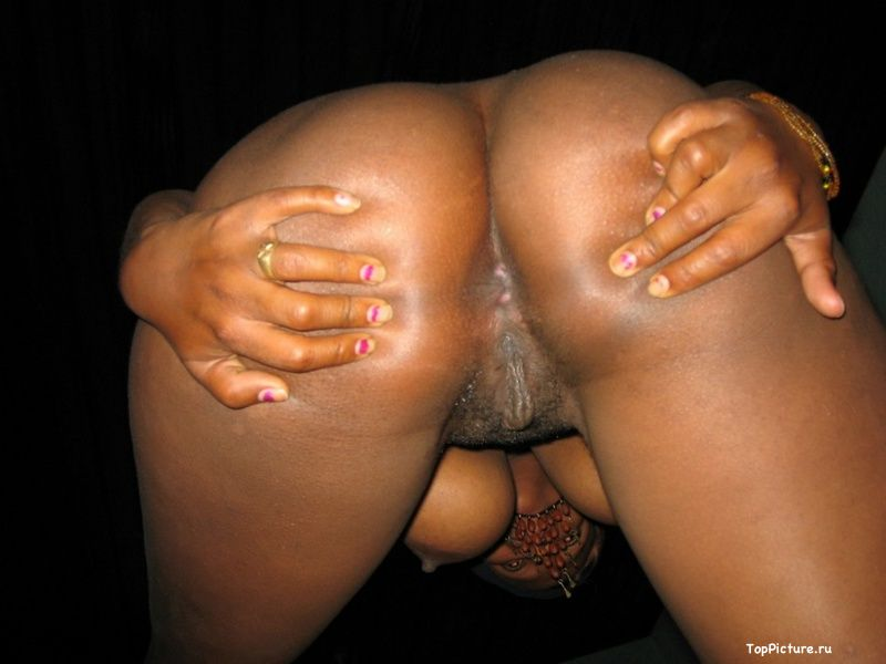 Plump black woman shows her pink pussy 20 photo