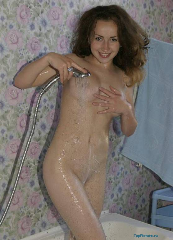 Fantastic brunette with cool tits bathed nude in the shower 1 photo