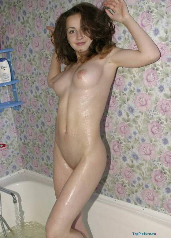 Fantastic brunette with cool tits bathed nude in the shower 15 photo