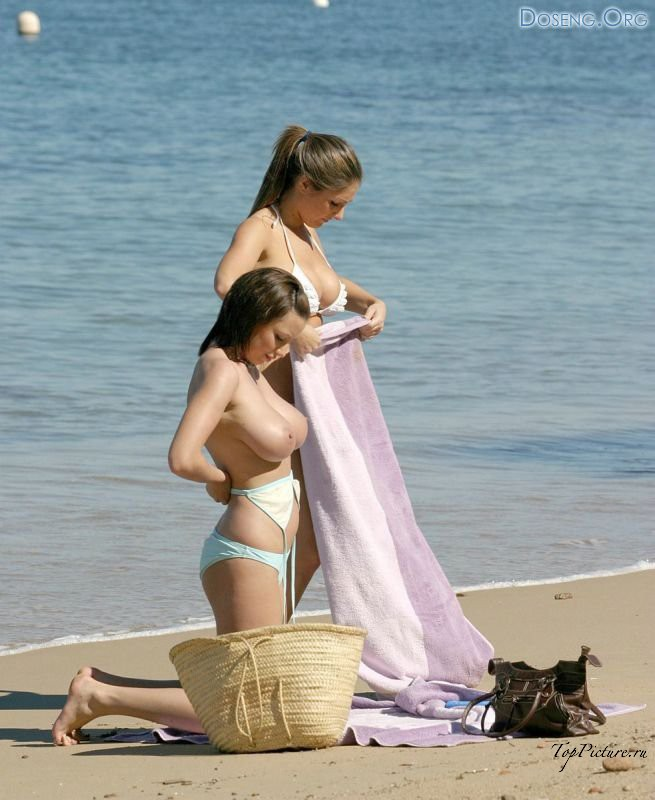 Young titted lesbians having fun on an empty beach 15 photo